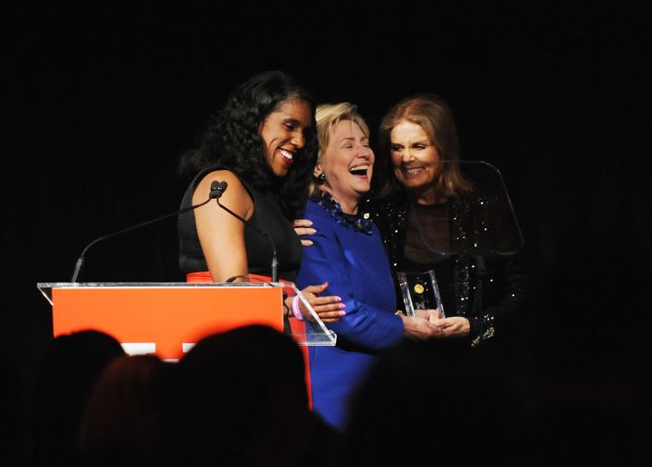 (L-R) Teresa C. Younger, Former US Secretary of State and WOV Honoree, Hilary Clinton and Gloria Steinem pose onstage at Ms.