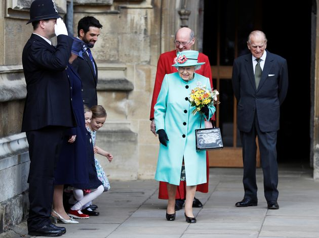 Girls curtsey as Britain's Queen Elizabeth and prince Philip leave the Easter Sunday service in Windsor...