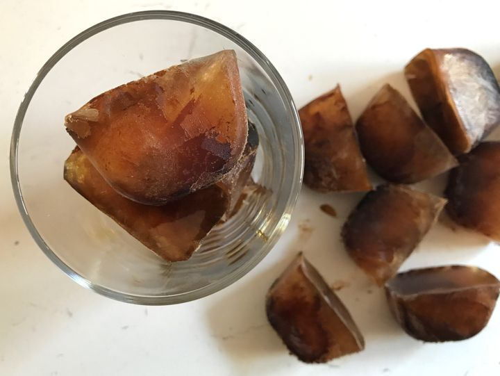 A glass of coffee ice cubes.