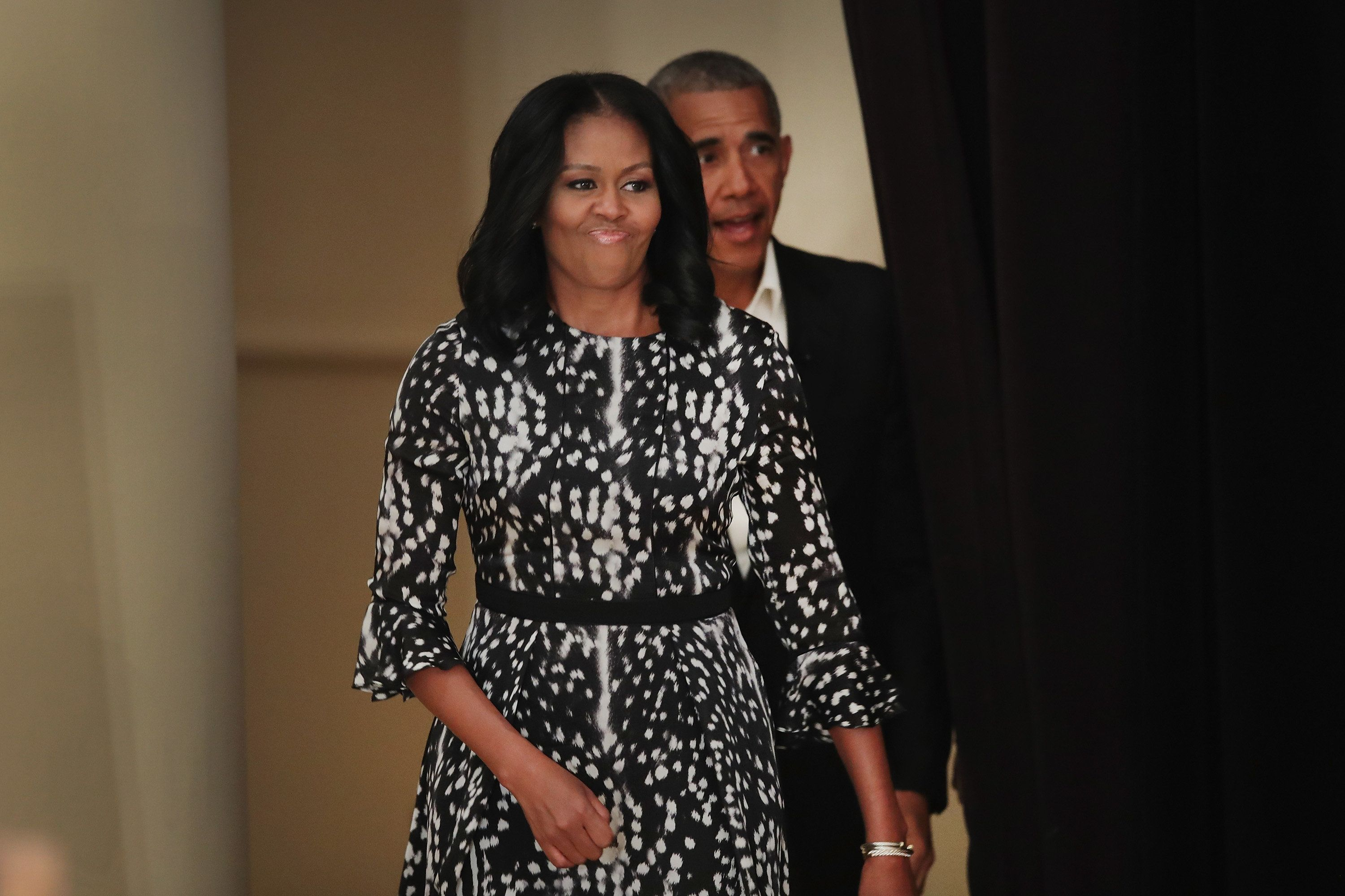 Former U.S. president Barack Obama and first lady Michelle Obama arrive to talk about the Obama Presidential Center during a community event at the South Shore Cultural Center on May 3 in Chicago, Illinois.