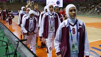 This photo taken on September 24, 2014 shows members of the Qatar women's basketball team walking off the court after withdrawing ahead of their women's preliminary round match against Mongolia during the 17th Asian Games at the Hwaseong Sports Complex Gymnasium in Incheon. Qatar on September 24 withdrew their women's basketball team from the Asian Games just before their first match over a rule banning Muslim headscarves.  Qatar and the Olympic Council of Asia (OCA) hit out at the International Basketball Federation (FIBA) rule which bans all headwear on safety grounds.   QATAR OUT    AFP PHOTO / AL-WATAN DOHA / KARIM JAAFAR        (Photo credit should read KARIM JAAFAR/AFP/Getty Images)