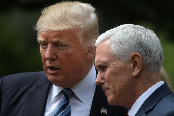 U.S. President Donald Trump and Vice President Mike Pence attend a National Day of Prayer event at the Rose Garden of the Whi