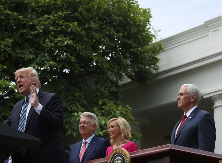 President Donald Trump speaks while Vice President Mike Pence, Pastor Paula White, and Pastor Jack Graham listen during a Nat