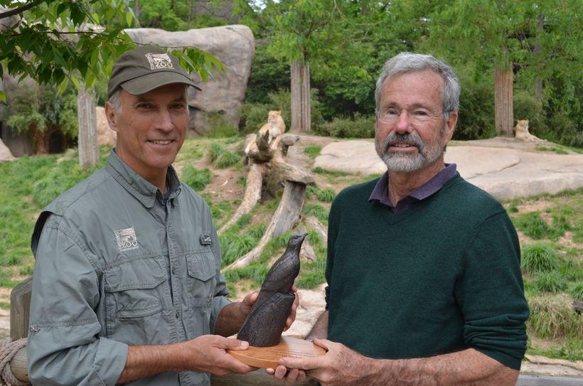 Cincinnati Zoo Director Thane Maynard presents the 2017 Wildlife Conservation Award to Dr. Craig Packer