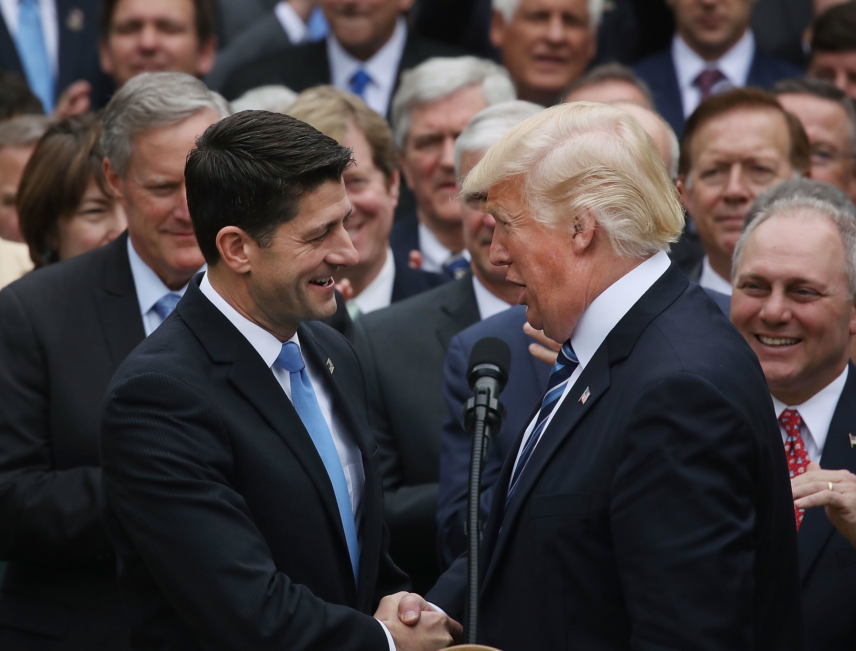 U.S. President Donald Trump congratulates House Speaker Paul Ryan (R-WI) after Republicans passed legislation aimed at repeal
