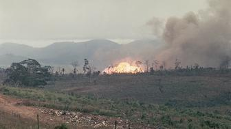(Original Caption) 2/25/1968-Khe Sahn, Vietnam- Napalm bombs and 250-pound snake eye bombs are shown as they go off in support of a pinned down Marine platoon that's been on patrol. More than half of the patrol was lost due to the heavy fighting.