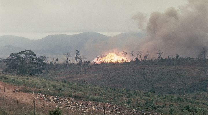 Napalm bombs and 250-pound snake eye bombs are shown as they go off in Khe Sahn, Vietnam. February, 1968.