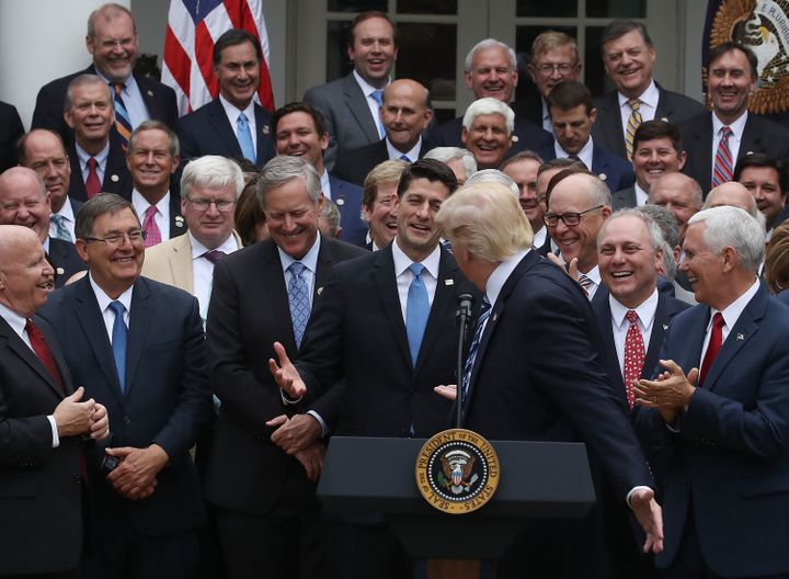 President Trump congratulates jubilant House Republicans after they voted to repeal major parts of Obamacare.