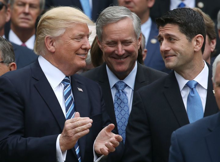 U.S. President Donald Trump (L), stands with House Speaker Paul Ryan (R-WI) (R) and Freedom Caucus Chairman Mark Meadows (R-N
