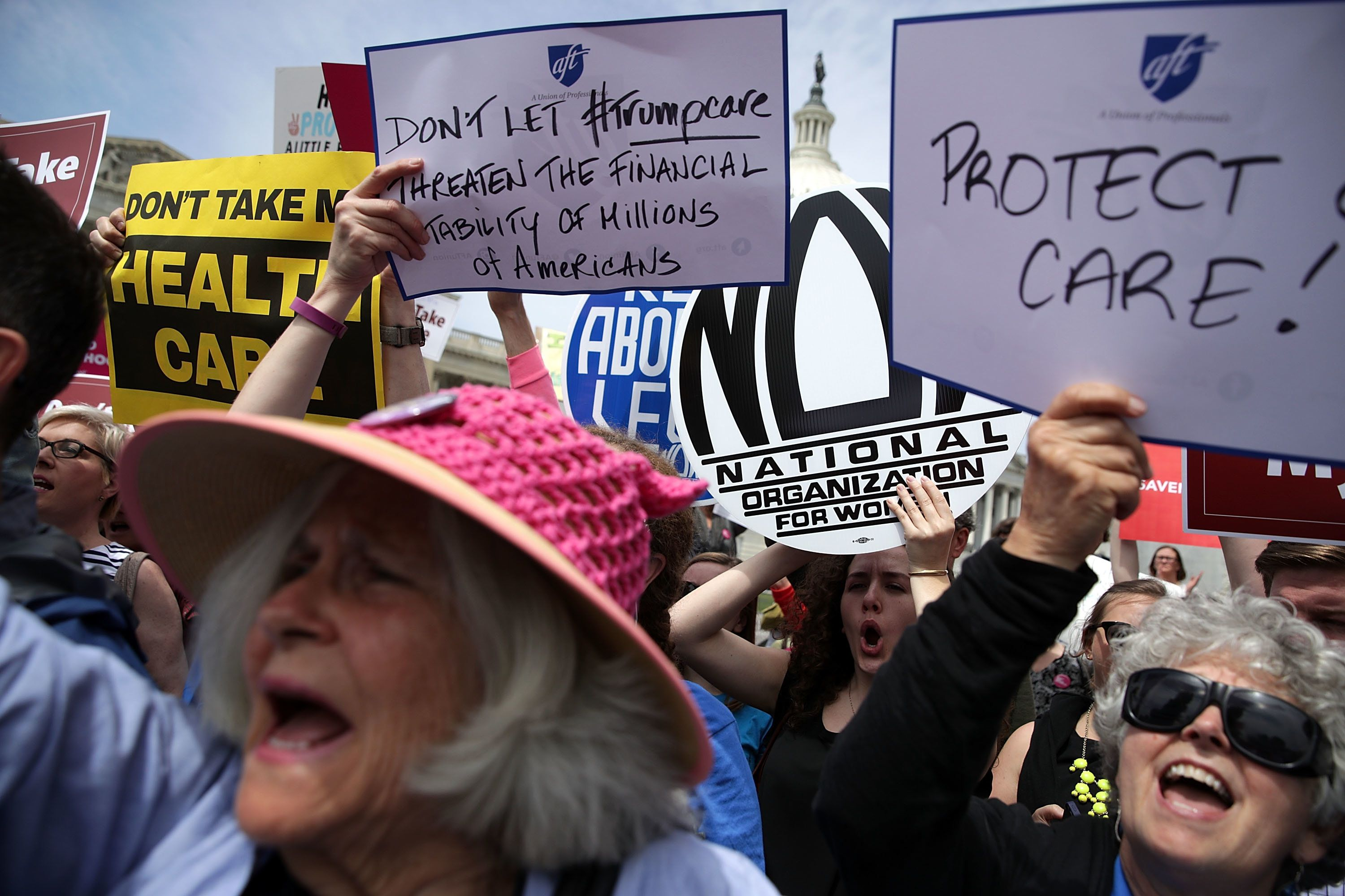 WASHINGTON, DC - MAY 04:  Activists hold signs during a Stop 'Trumpcare' rally May 4, 2017 in front of the Capitol in Washington, DC. Congressional Democrats joined activists for a rally to urge not to replace Obamacare, also known as the Affordable Care Act.  (Photo by Alex Wong/Getty Images)
