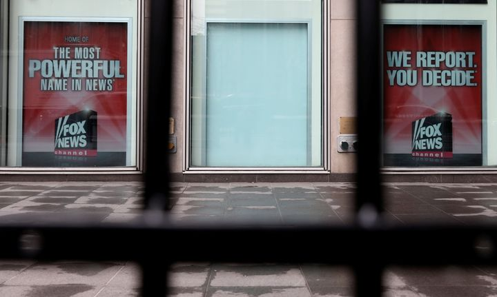 A white board is seen where a poster for former Fox News Channel anchor Bill O'Reilly used to hang outside News Corp. headqua