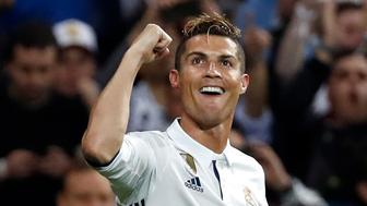MADRID, SPAIN - MAY 02: Cristiano Ronaldo of Real Madrid celebrates after scoring the third goal during the UEFA Champions League semi-final first leg match between Real Madrid CF and Club Atletico de Madrid at Estadio Santiago Bernabeu on May 2, 2017 in Madrid, Spain. (Photo by TF-Images/Getty Images)