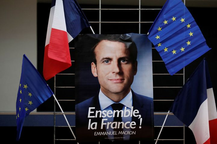 An electoral poster of Emmanuel Macron, France's centre-left presidential candidate, calling for unity.