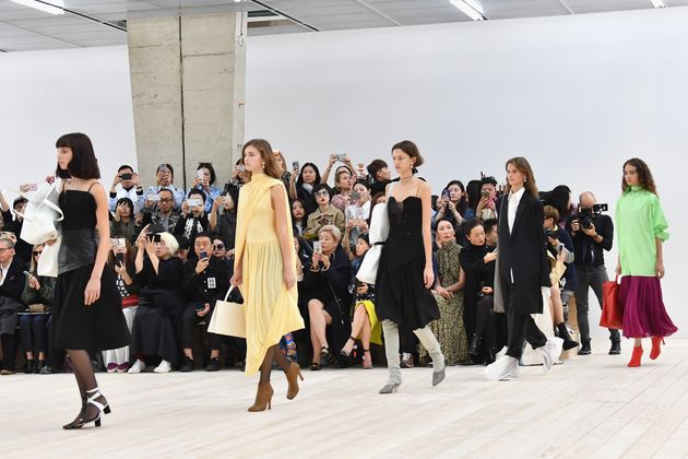 Models walk the runway during the Celine show during Paris Fashion Week for spring/summer 2017 on 2 October...