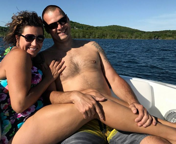 Couple's Holiday Photo Creates A Hilariously Rude Optical