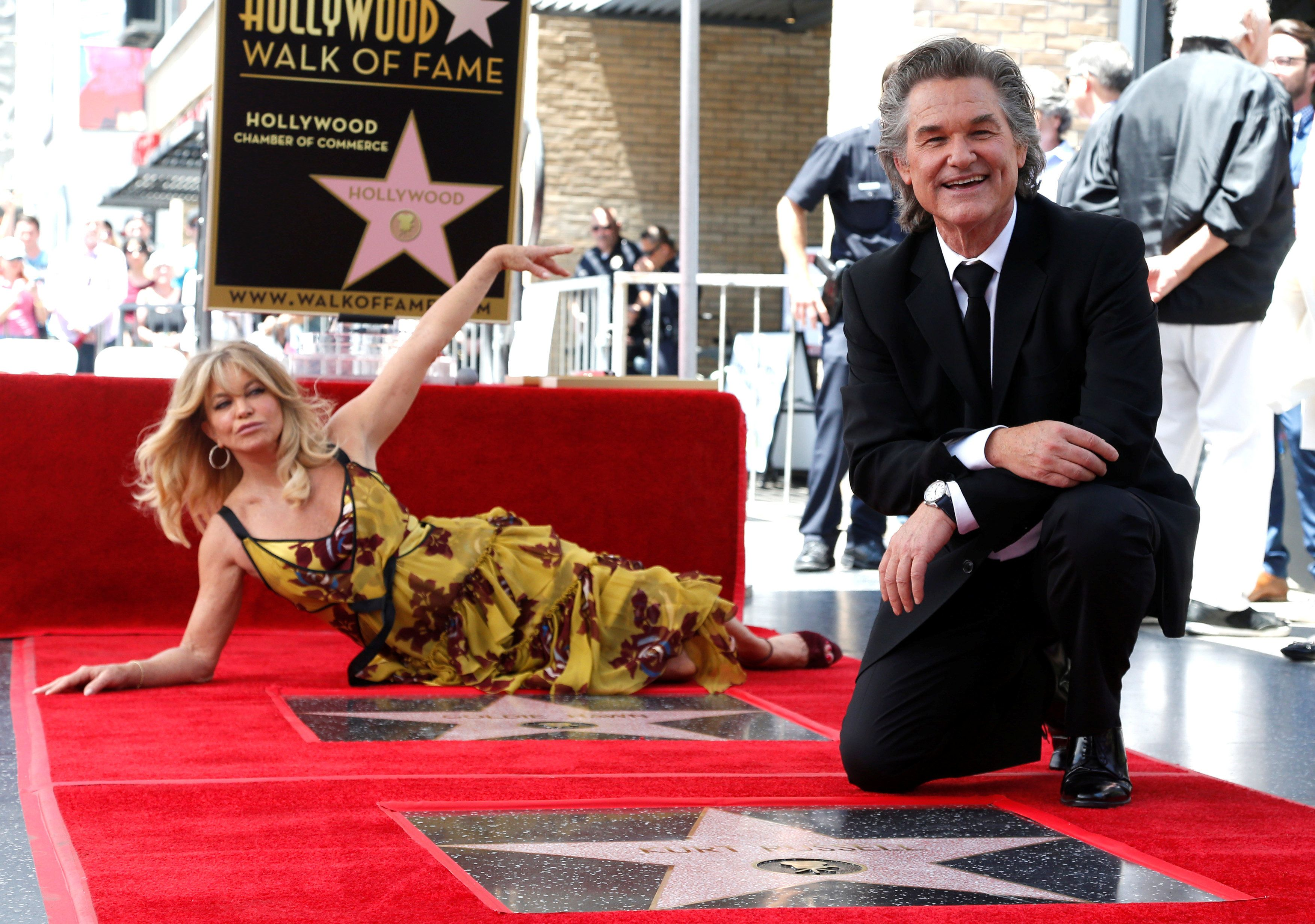 Actors Kurt Russell and Goldie Hawn pose on their stars after being unveiled on the Hollywood Walk of Fame in Los Angeles, California, U.S. May 4, 2017.   REUTERS/Mario Anzuoni
