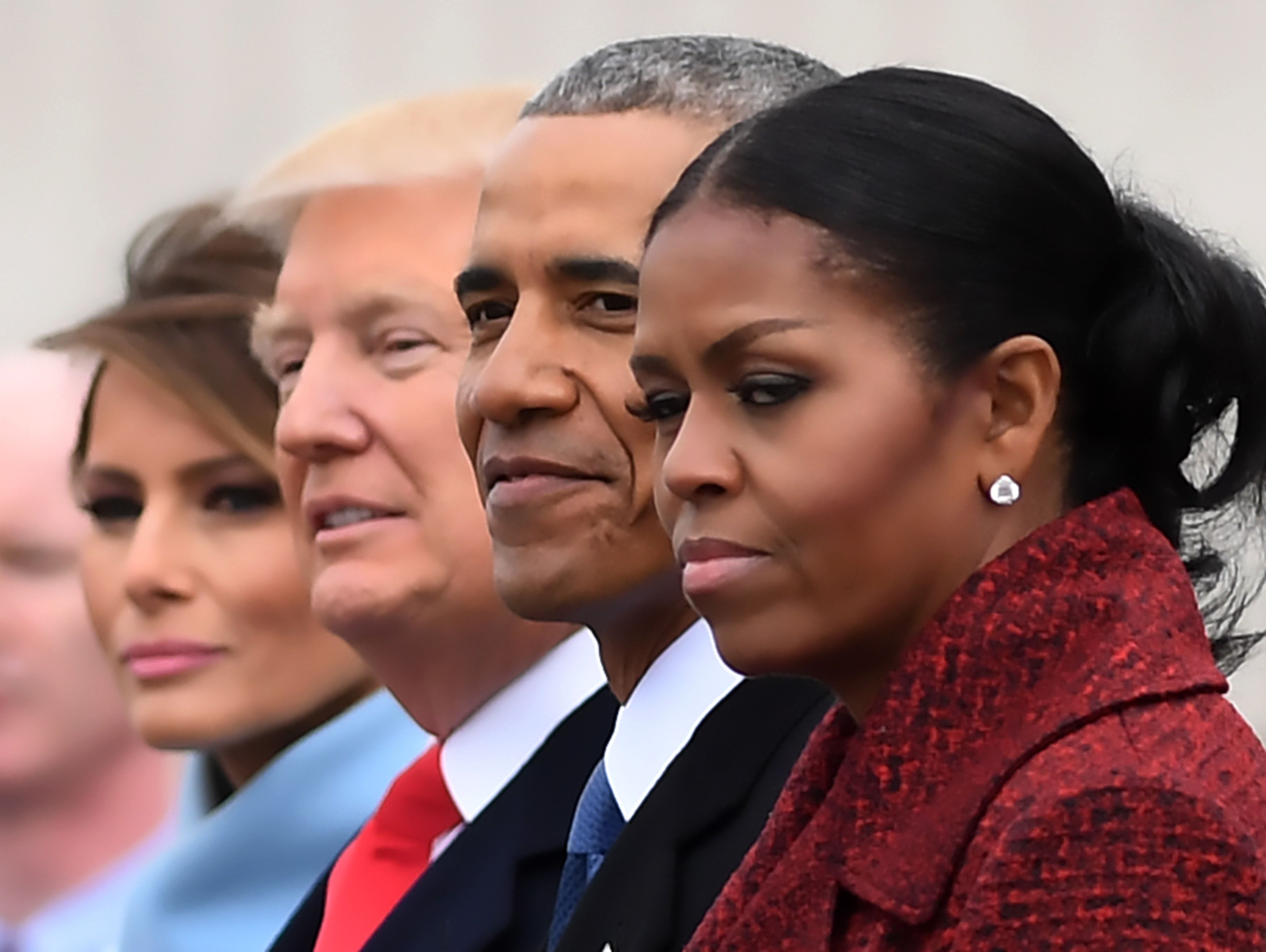 (FILES) L-R: First Lady Melania Trump, President Donald Trump,former President Barack Obama, Michelle Obama at the US Capitol after inauguration ceremonies at the in Washington, DC, on January 20, 2017. While the new US president has shown a capacity to change, both his tone and his positions, he has been unable to show the world a 'new' Trump, with a steady presidential style and a clearly articulated worldview. As the symbolic milestone of his 100th day in power, which falls on April 29, 2017, draws near, a cold, hard reality is setting in for the billionaire businessman who promised Americans he would 'win, win, win' for them. At this stage of his presidency, he is the least popular US leader in modern history (even if his core supporters are still totally behind him.) / AFP PHOTO / JIM WATSON / TO GO WITH AFP STORY, US-politics-Trump-100days         (Photo credit should read JIM WATSON/AFP/Getty Images)