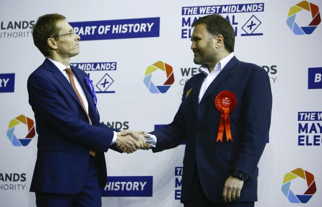 Tory Andy Street congratulated by Labour's Sion