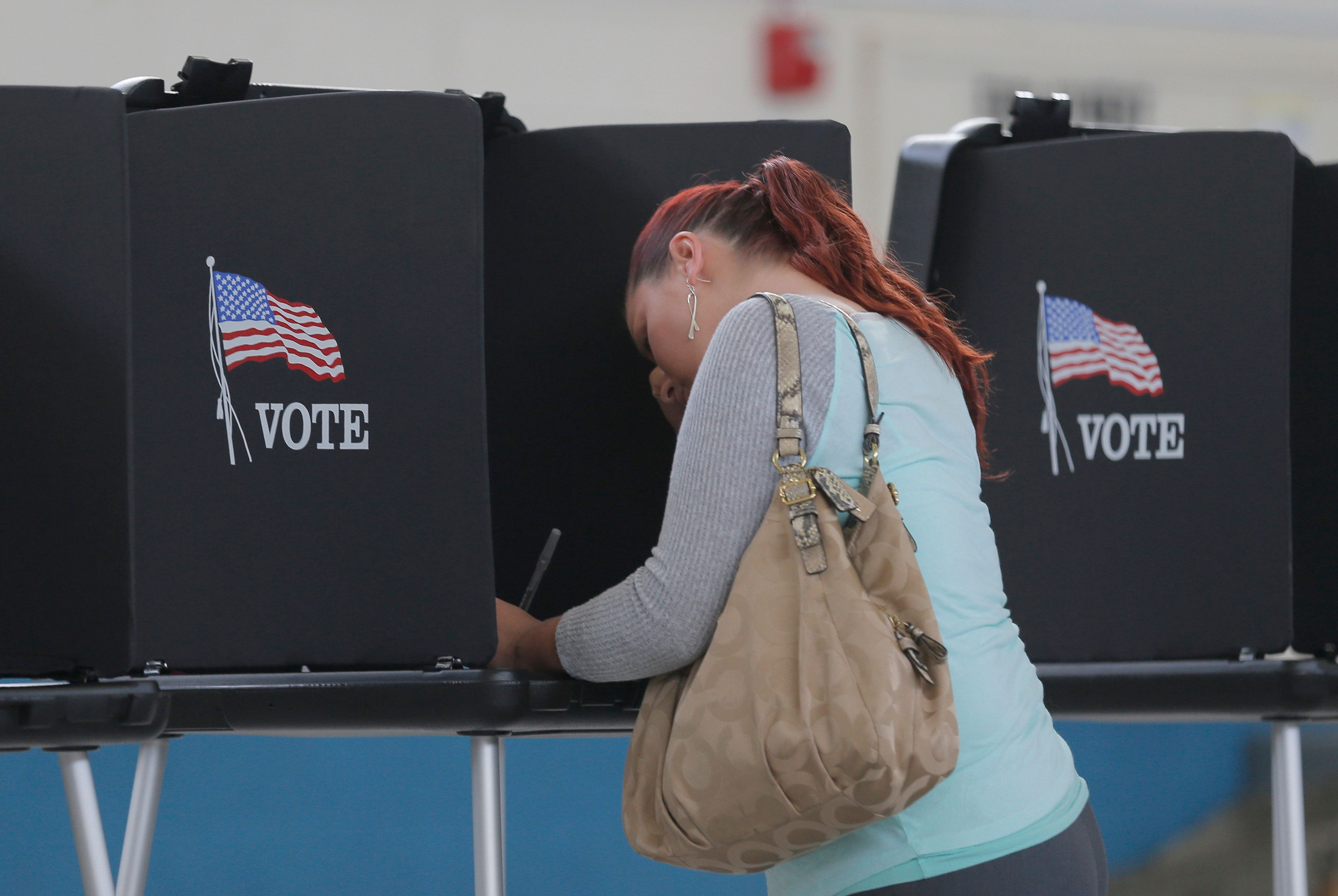 Melissa Foye fills out her ballot as she votes in the U.S. presidential election at the National Guard Armory in Smithfield, North Carolina, U.S. November 8, 2016. REUTERS/Chris Keane