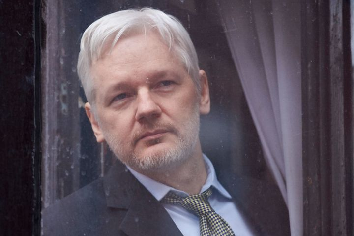 WikiLeaks founder Julian Assange looks out of the balcony window of the Ecuadorian embassy in central London on February 5, 2