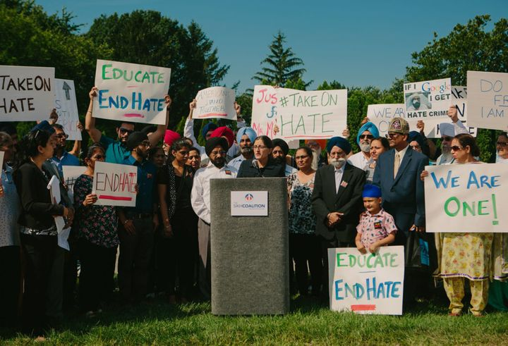 Harsimran Kaur, legal director for the Sikh Coalition, addresses a rally in response to a hate crime in Chicago sub