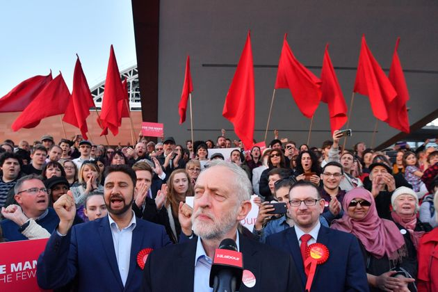 There were a sea of red flags behind Corbyn as he