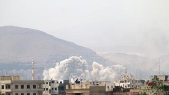 DAMASCUS, SYRIA - MAY 04: Smoke rises after Assad regime forces attacked opposition controlled Qaboun district of Damascus, Syria on May 04, 2017. Regime forces hit residential areas with ground and air strikes.  (Photo by Samir Tatin/Anadolu Agency/Getty Images)