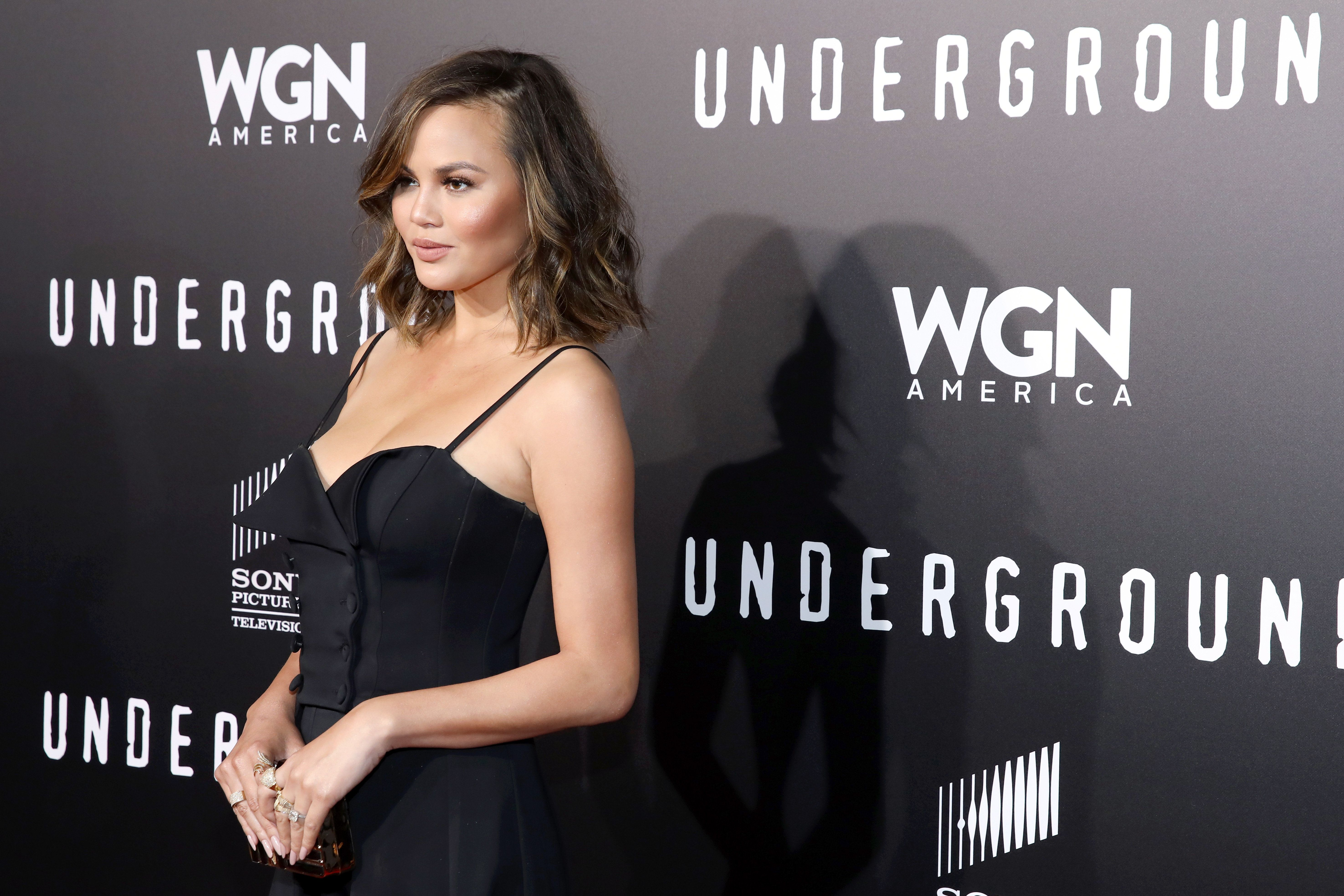 WESTWOOD, CA - FEBRUARY 28:  Model Chrissy Teigen attends WGN America's 'Underground' Season Two Premiere Screening at Regency Village Theatre on March 1, 2017 in Westwood, California.  (Photo by Rachel Murray/Getty Images for WGN America)