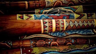 Pile of didgeridoos in a shop for sale