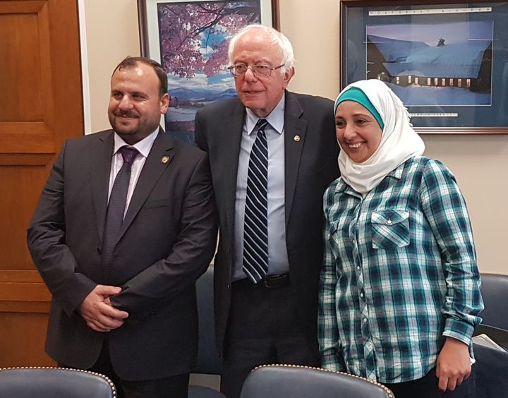 White Helmets leader Mounir Mustafa, left, and volunteer Manal Abazeed meet with Sen. Bernie Sanders (I-Vt.) on April 25 in Washington. It was Sanders'first meeting with the Syrian group.