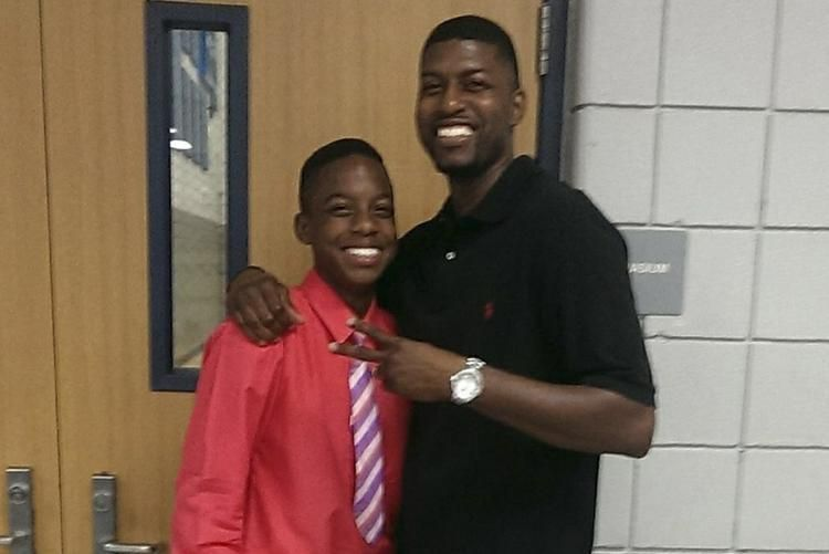 Jordan Edwards with his father, Odell Edwards share a laugh during happier times.