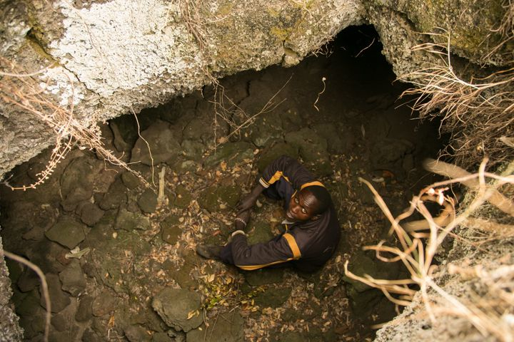 Amos Kiptui, 27, sits in a cave.