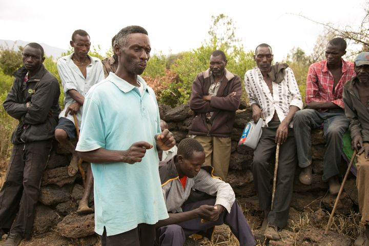 Joseph Kariuki speaks to locals about getting treated for the flesh-eating disease cutaneous leishmaniasis.