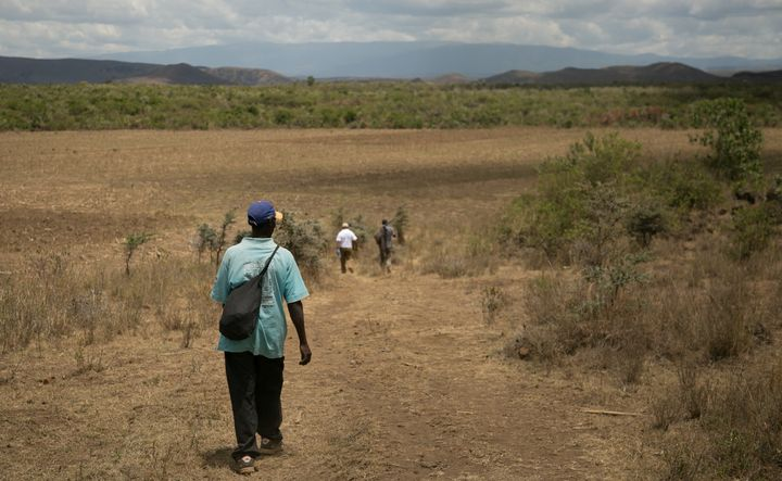 Hiking through the Kenyan bush, en route to the Utut Forest caves.