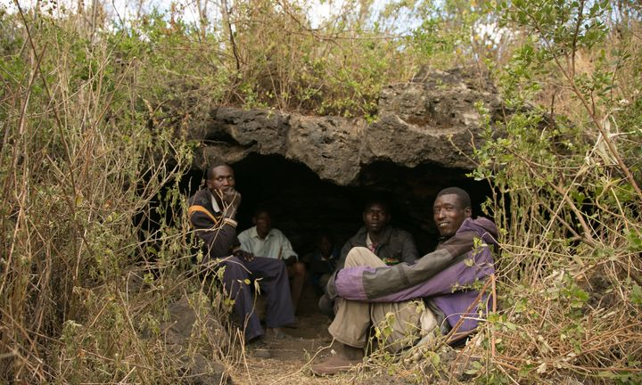 A group of friends in Kenya's remote Utut Forest, where 300 people live in caves. An outbreak of cutaneous lei