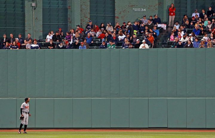 Adam Jones is pictured as he looks up into the centerfield bleachers.