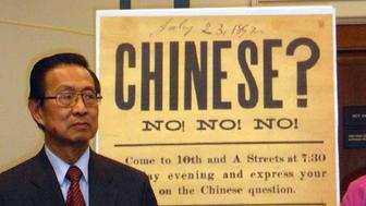TO GO WITH AFP STORY by SHAUN TANDON, US-China-immigration-history-minority   Michael Lin, chair of the 1882 Project, a coalition of rights groups seeking a statement of regret over that year's Chinese Exclusion Act, speaks on May 26, 2011 in Washington, DC, at the US House of Representatives in front of a reproduction of a 19th-century sign that aimed at rousing up sentiment against Chinese Americans. Lawmakers introduced a bill that would offer an official statement of regret for the act, which banned further immigration of Chinese to the United States and ended citizenship rights for ethnic Chinese.    AFP PHOTO/SHAUN TANDON (Photo credit should read SHAUN TANDON/AFP/Getty Images)