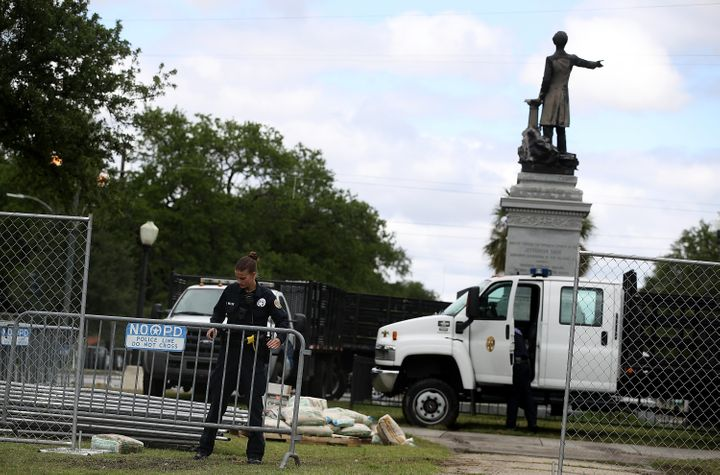 New Orleans police officers set up barricades at the Jefferson Davis monument on May 4, 2017 in New Orleans, Louisiana.