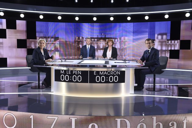 French presidential election candidates Marine Le Pen and Emmanuel Macron pose prior to the start of...