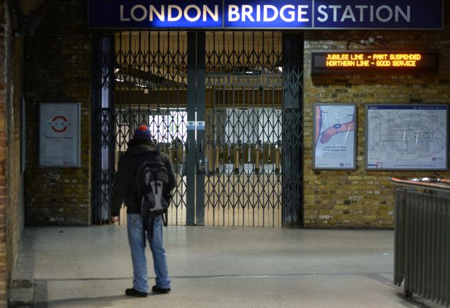 A man looks at locked gates at London Bridge station, London, as a strike by London Underground workers...