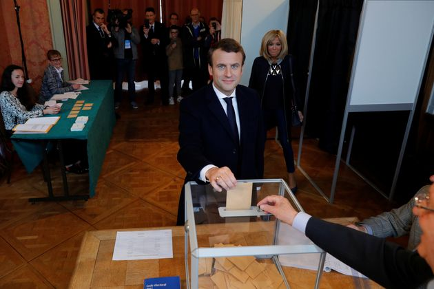 French presidential election candidate Emmanuel Macron casts his ballot. Opinion polls gave Macron...