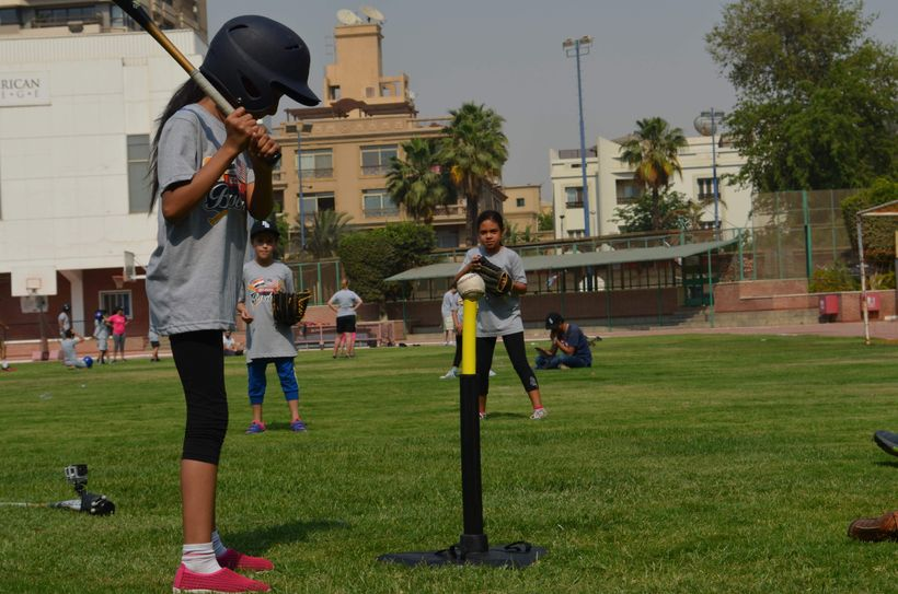 Egyptian girl during a batting practice in Cairo as part of the  2-week Cairo Youth Baseball Training