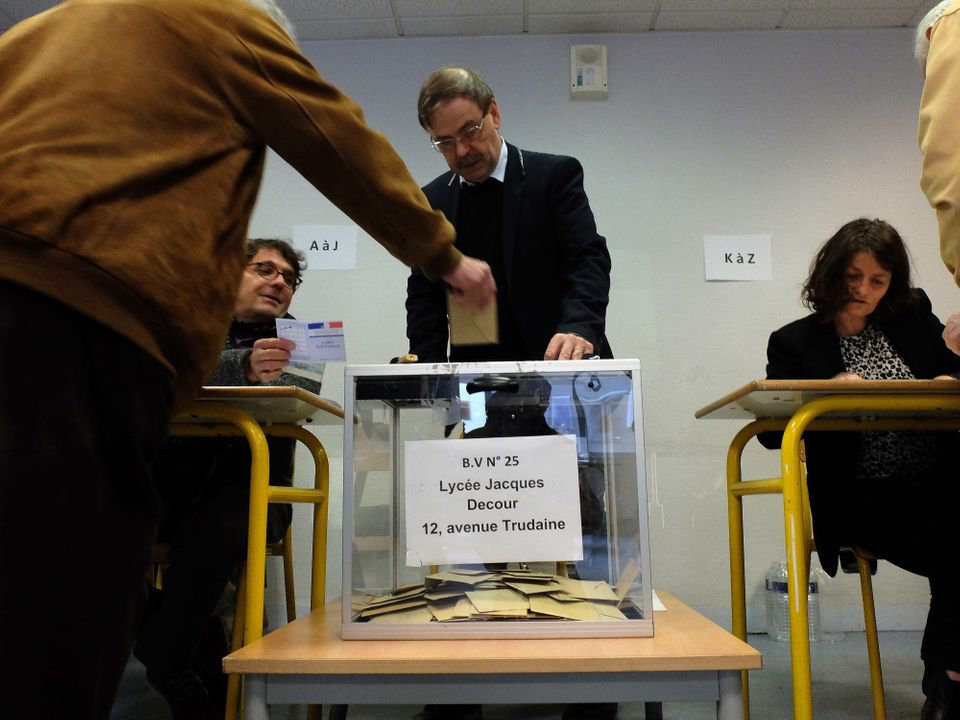 Voters go to the polls in the second round of France's presidential elections.