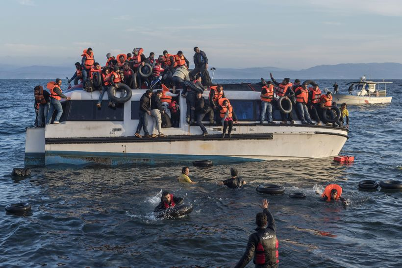 <em>Syrian and Iraqi refugees reach the coastal waters of Lesbos in Greece, after having crossed from Turkey. </em>