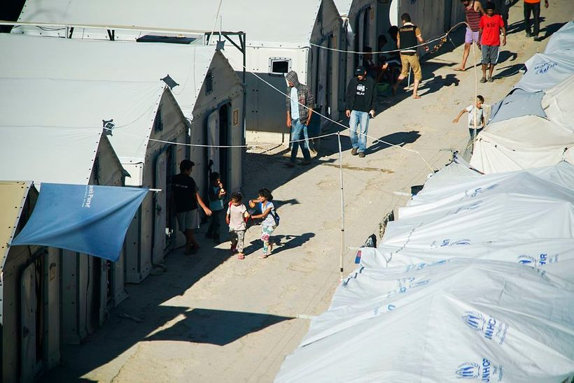 <em>Inhabitants of Suda refugee camp at one of it's alleys, Chios, Grece, Aegean Sea. </em>