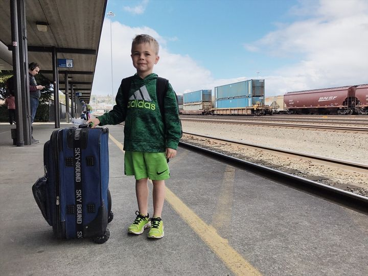 My 5-year-old son at the train station during a mother-son trip to the Northwest.