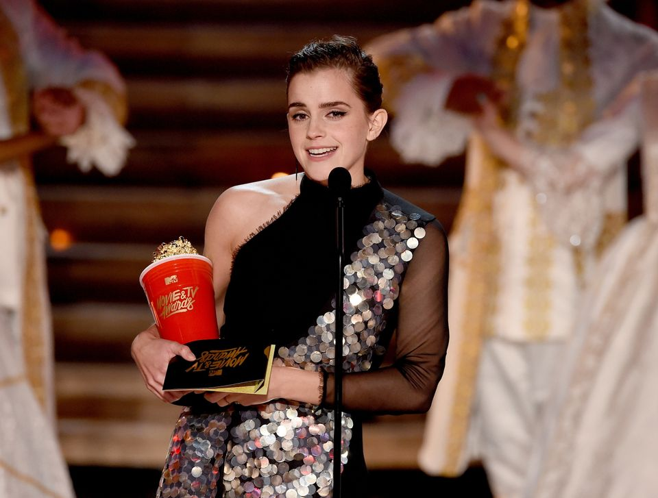 Actor Emma Watson accepts Best Actor in a Movie for 'Beauty and the Beast' onstage during the 2017 MTV Movie And TV Awards at