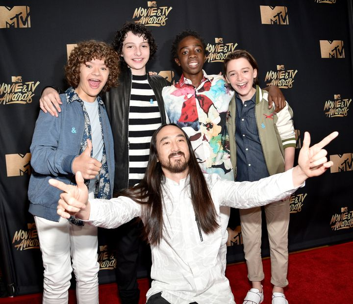 Gaten Matarazzo, Finn Wolfhard, Caleb McLaughlin, Noah Schnapp and (front) DJ Steve Aoki attend the 2017 MTV Movie And TV Awa