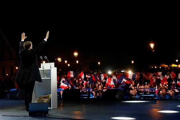 French President elect Emmanuel Macron celebrates on stage during his victory rally near the Louvre
