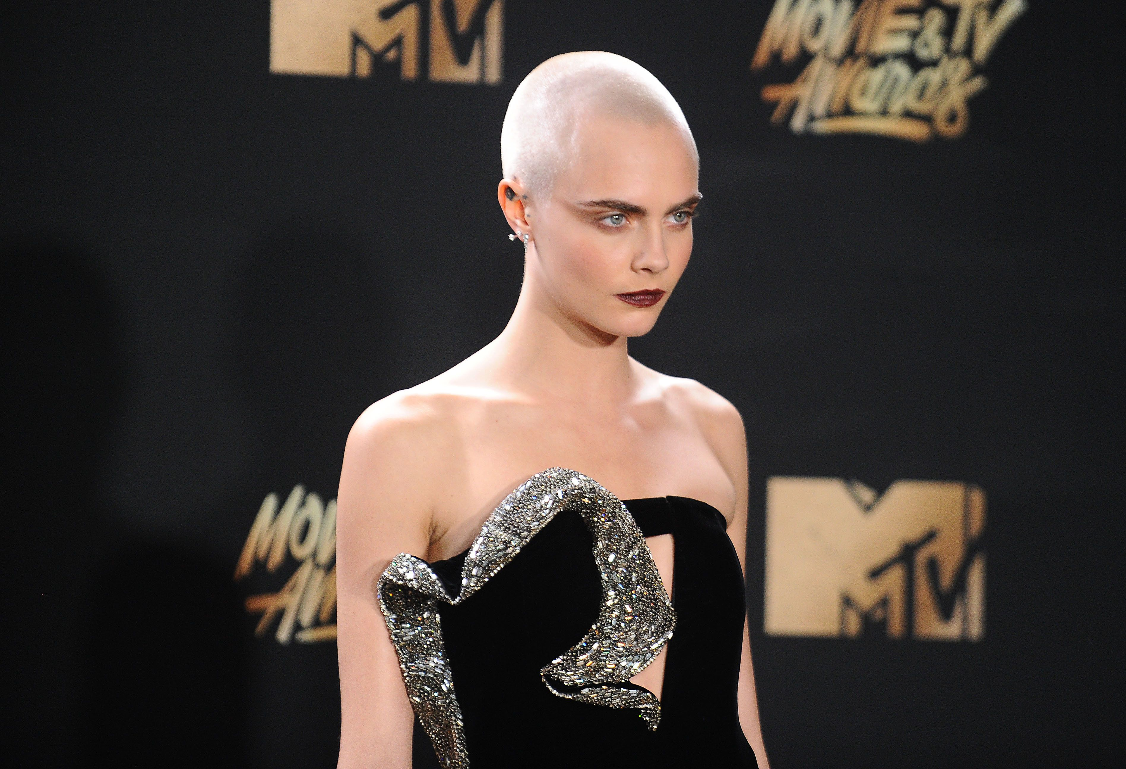 Cara Delevingne poses at the 2017 MTV Movie and TV Awards at The Shrine Auditorium on 7 May 7 2017 in...